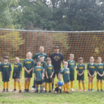members of the sub novice soccer team winning their first game of the season