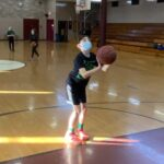 Matteo preparing for a basketball free throw shot at the foul line