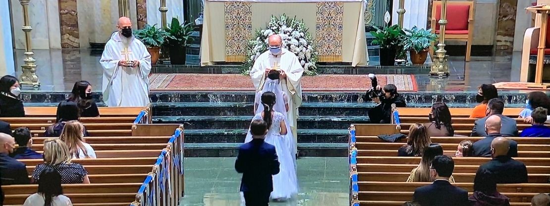students receiving first communion